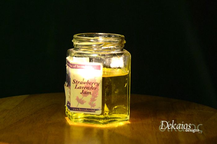This candle is made from pouring olive oil into a used jar I really liked, then adding a wick. Olive oil will burn slow and provide a fun candle that can just be refilled at any time! Great idea to recycle old jars with cool labels.