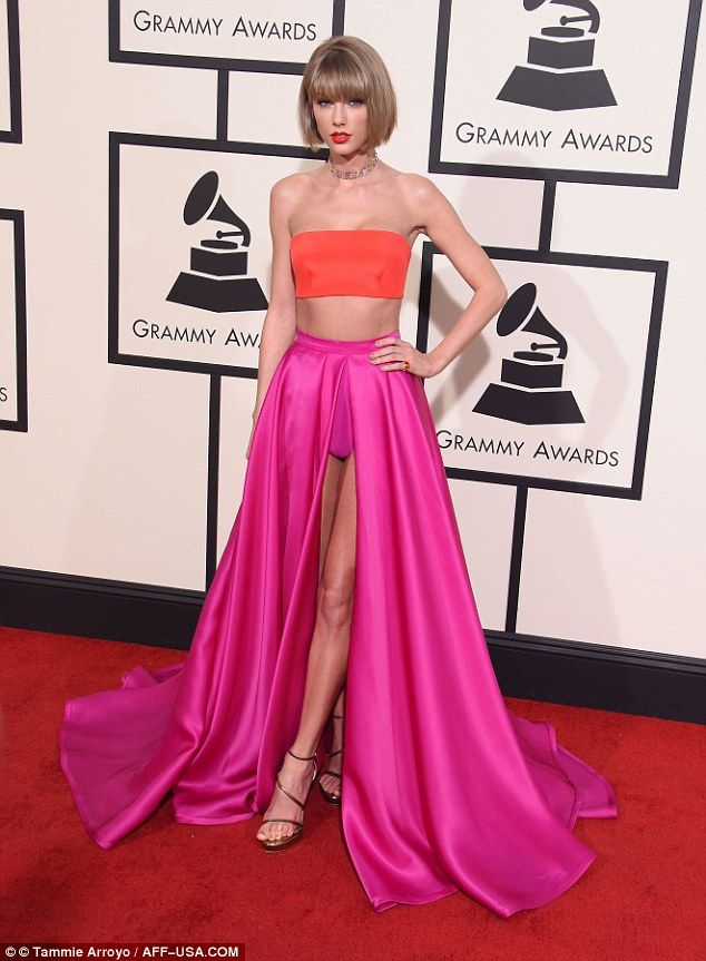 Bright spark: As she walked the red carpet at the awards ceremony, Taylor flaunted her lovely figure in a pink and orange two-piece combo