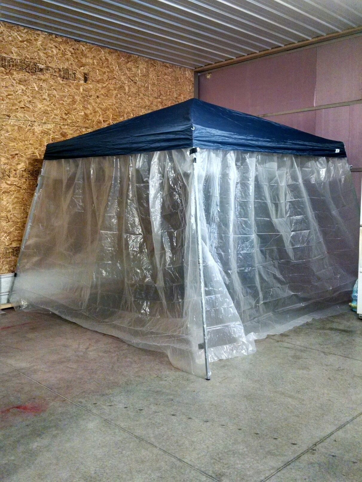 Makeshift paint booth. Used our canopy and 12x9 sheets of