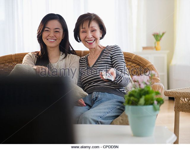 Asian Family Watching Television Stock Photos & Asian Family ...
