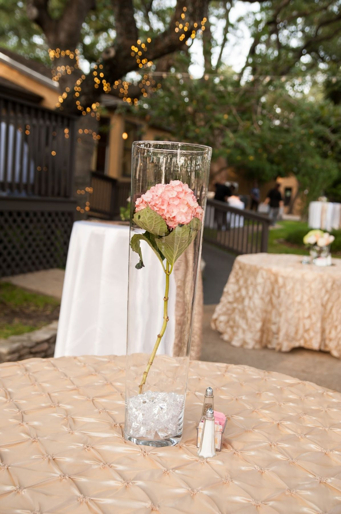 Easy way to decorate when you have over 30 tables and still have that elegant effect at night the crystals beam with beautiful pink colors .
