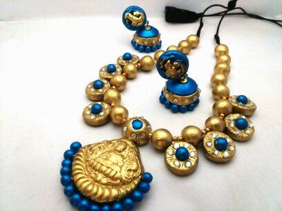 Attractive temple jewellery in lakshmi  design. short necklace in fully gold color and little blue. Matching earring is given. Dispatch time 6 to 8 days.