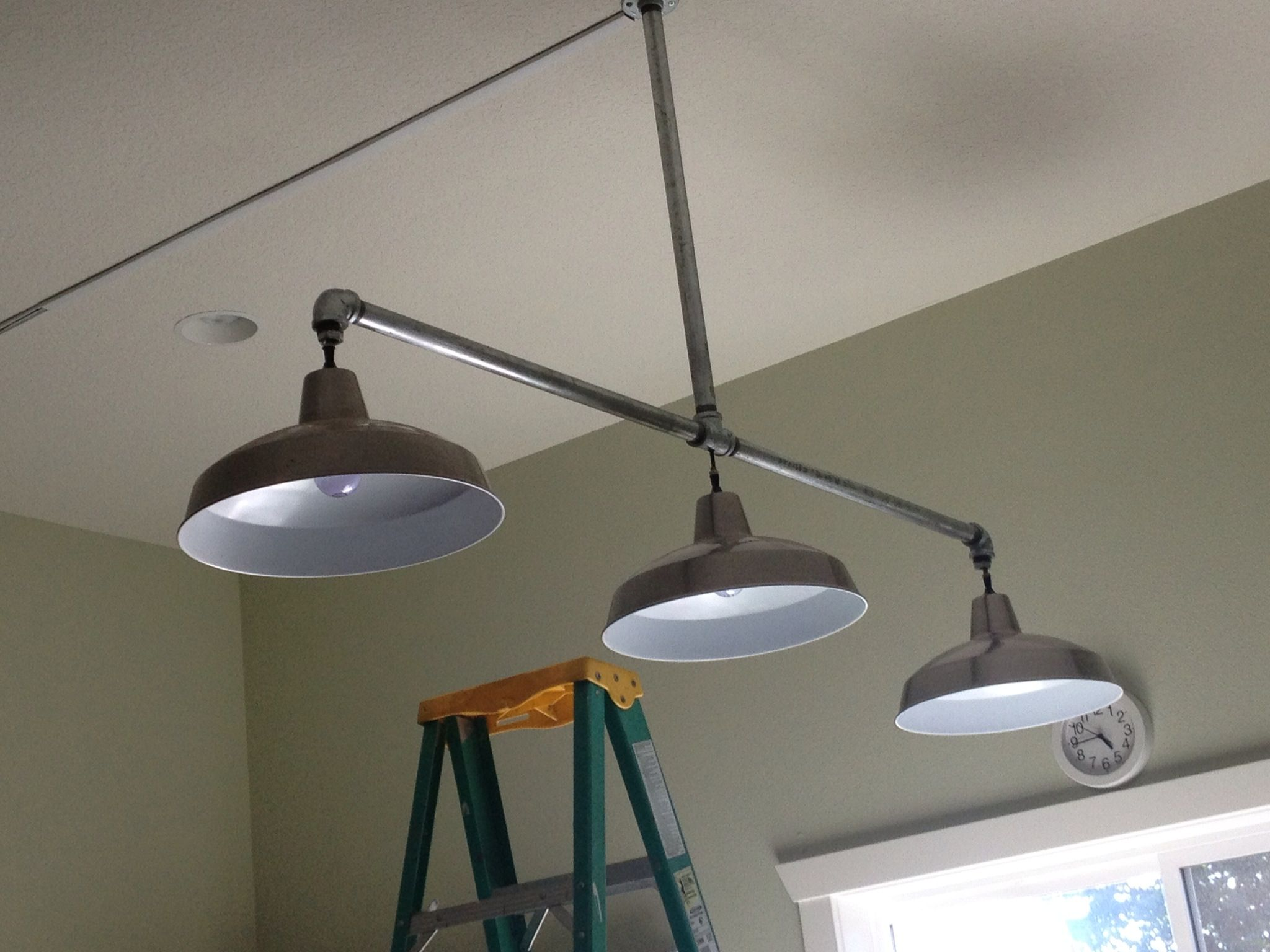 New lights hubby made for craft room Galvanized pipe from Lowes