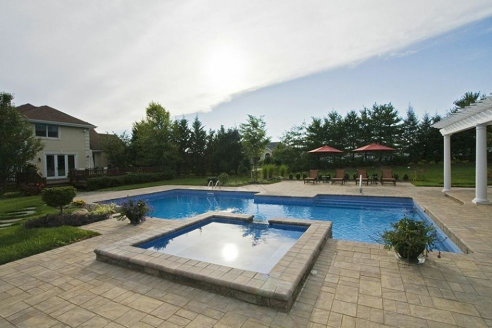 Award winning design geometric pool with raised spa hot for Raised pool designs
