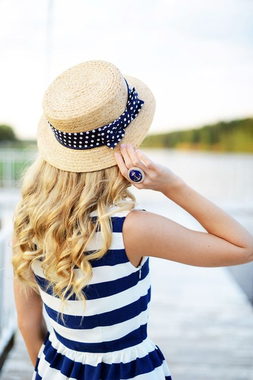 Navy and white striped dress. Hat with navybribbon with white polka dots. Navy anchor ring.