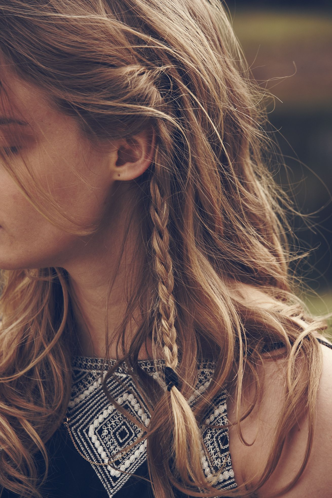 Plait front sections of your hair to keep it from falling in your face during your favourite band's set.