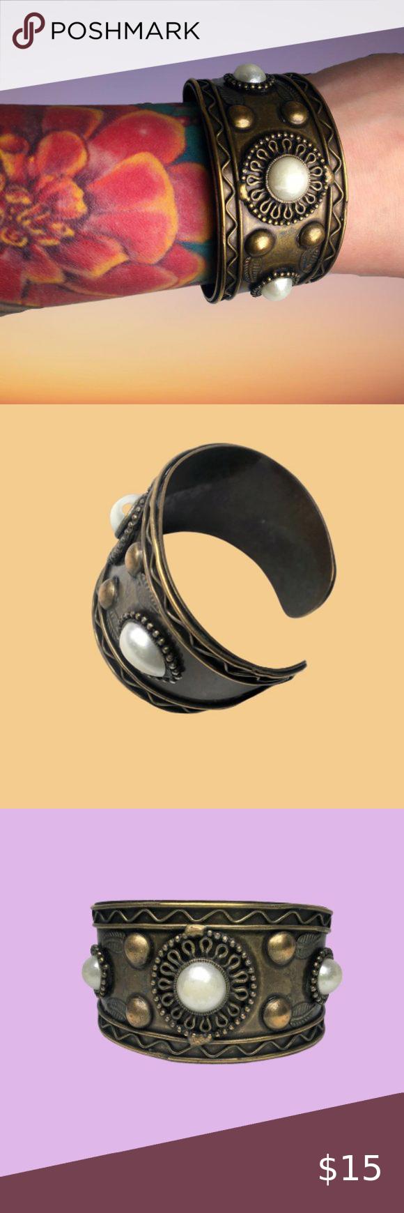 GOld tone cuff bracelet with costume pearls detail GOld tone cuff bracelet with costume pearls detail #cuff #statement #bracelet #superhero #wonderwoman Jewelry Bracelets