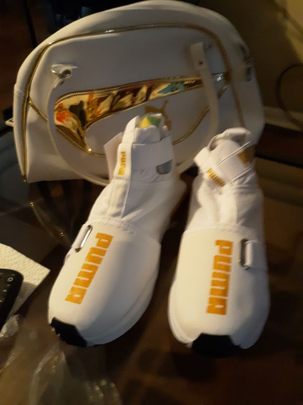 white and gold puma shoes and purse