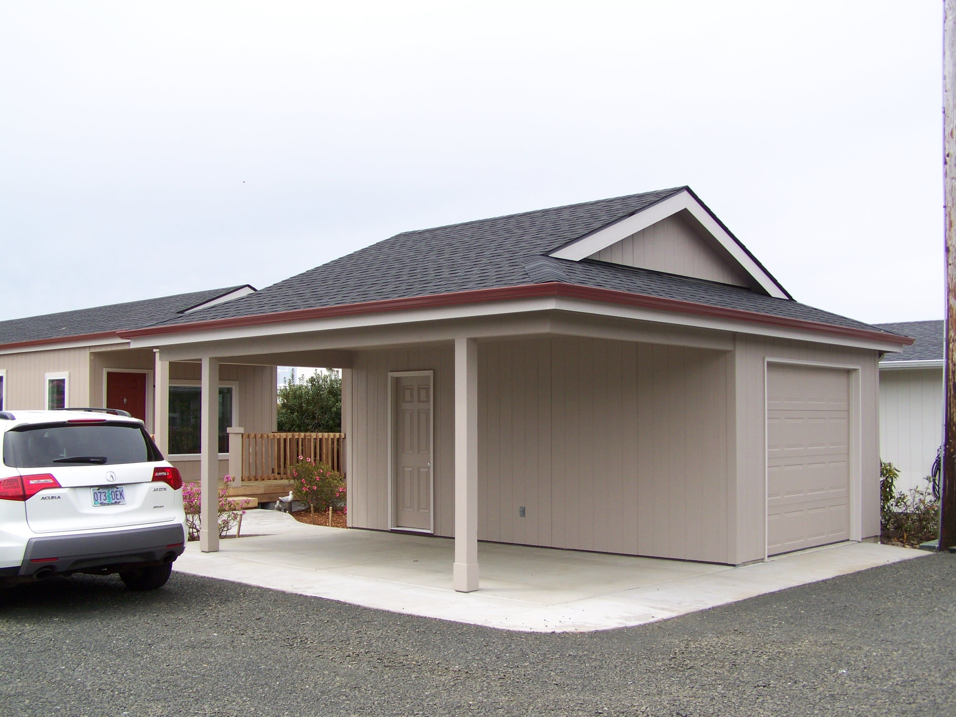 A Garport Half Garage Half Carport Get More Information About This Or Other Plans At Cdihomeplans Com Or On Garage Door House Carport Garage Garage House