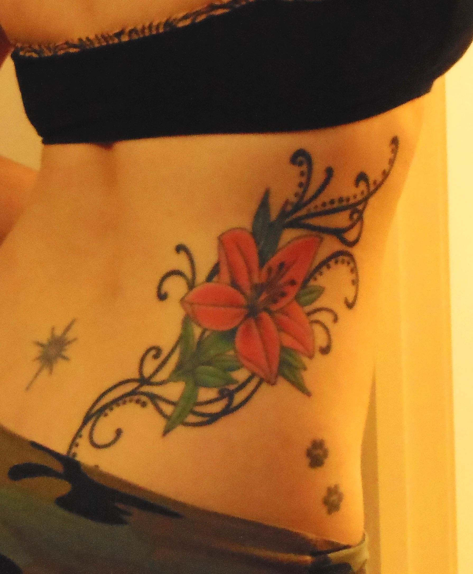 Paw Print Tattoos With Flowers: Lily Tattoo, Paw Print Tattoo, Starburst Tattoo, Hip