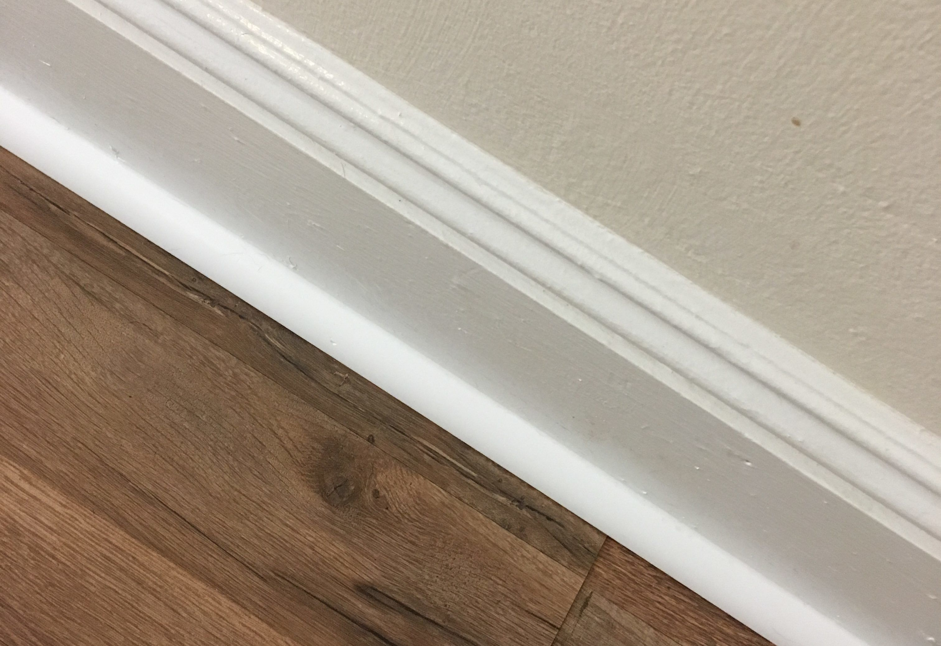 How To Install Quarter Round Molding With A Hammer And Nails Cabana State Of Mind Installing Laminate Flooring Laminate Flooring Quarter Round Molding