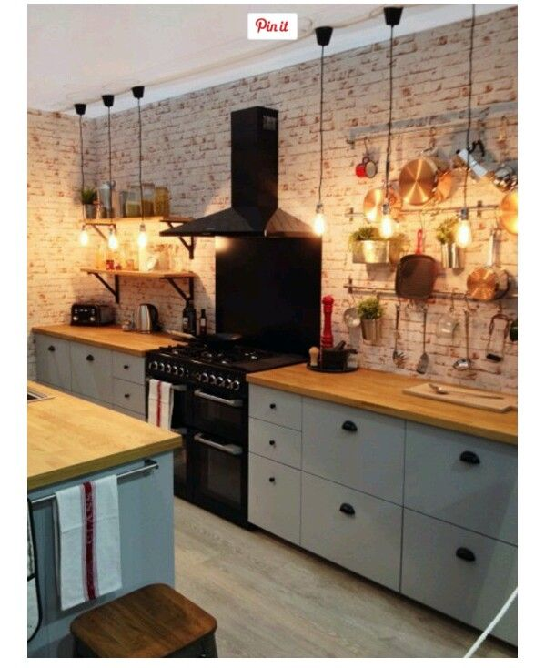 Low Hanging Light Bulbs Hanging Utensils Brick Effect Wall The - Low hanging kitchen lights