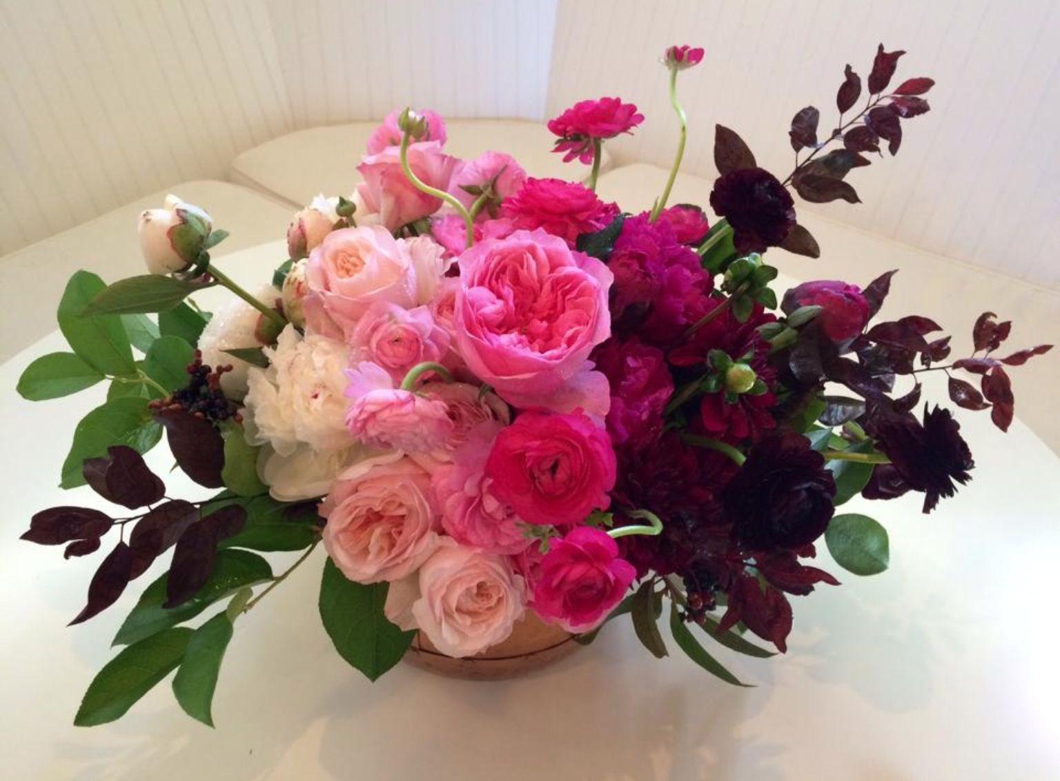 Pink ombre centerpiece is made of white peony light