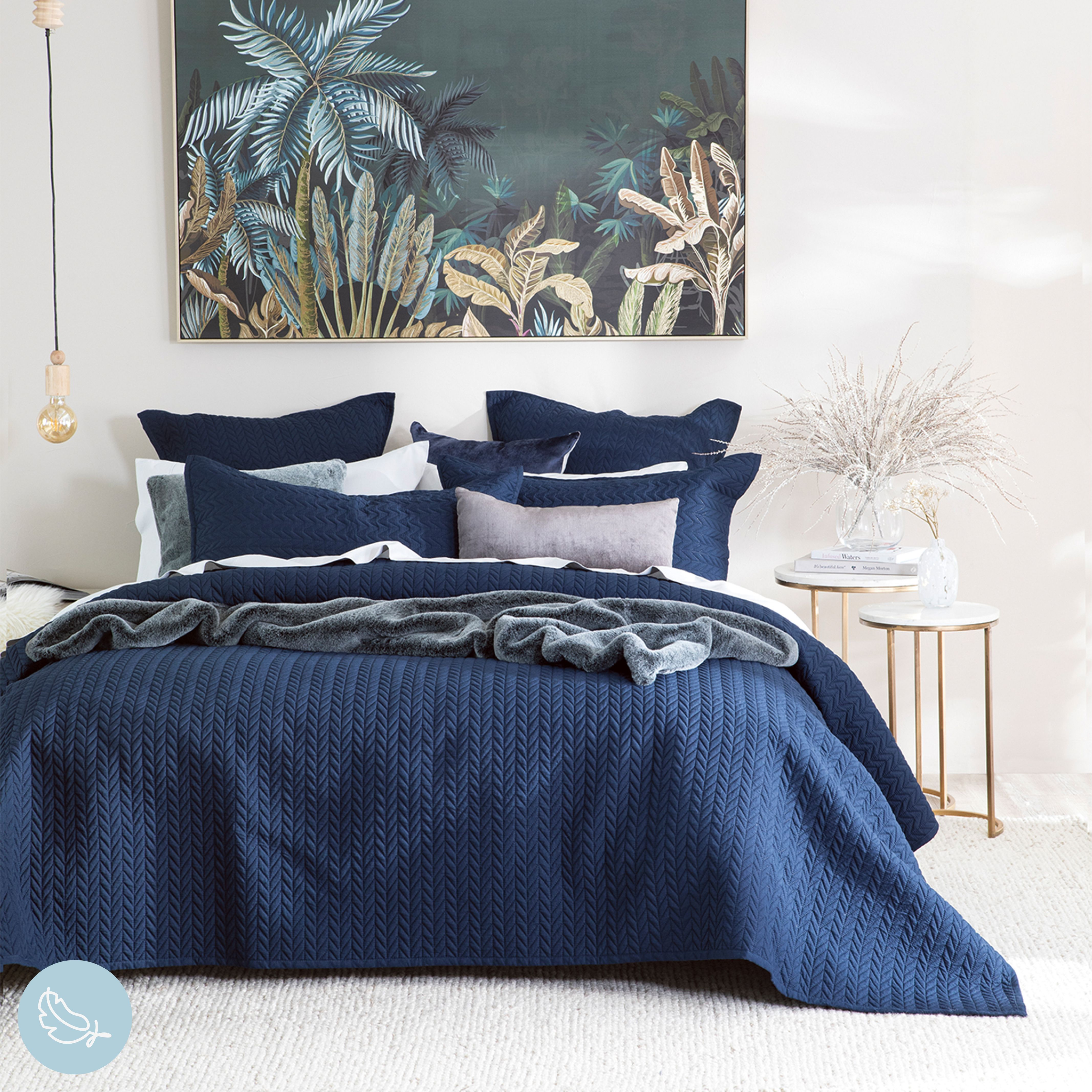 The gorgeous Camden coverlet in navy ink is perfectly styled here with faux fur and luxe textures to create a warm winter space. #PillowTalkAustralia #ForTheLoveOfComfort #bedroomdecor #bedroomstyling #coverlet #bedroom #diyhomedecor #bed #bedroomstyle