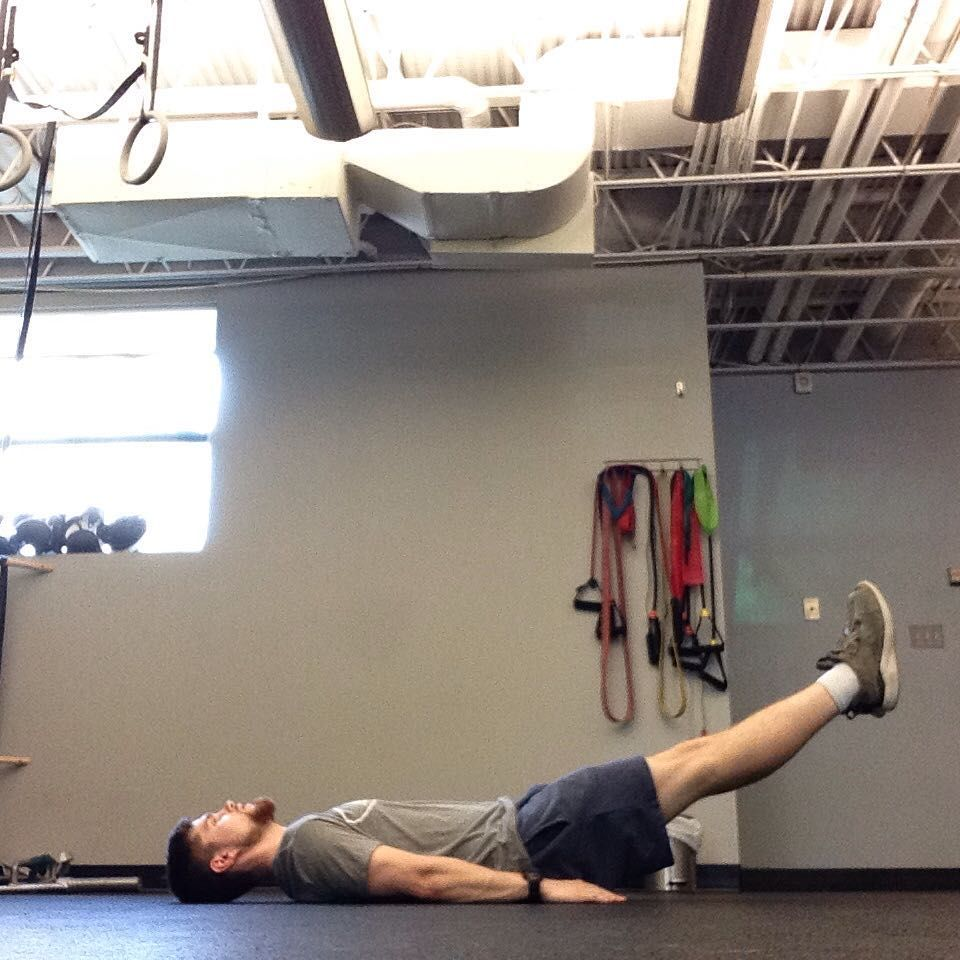 #exerciseoftheweek 6 inch leg holds! For this isometric ab exercise, lie face up on a mat or sof...
