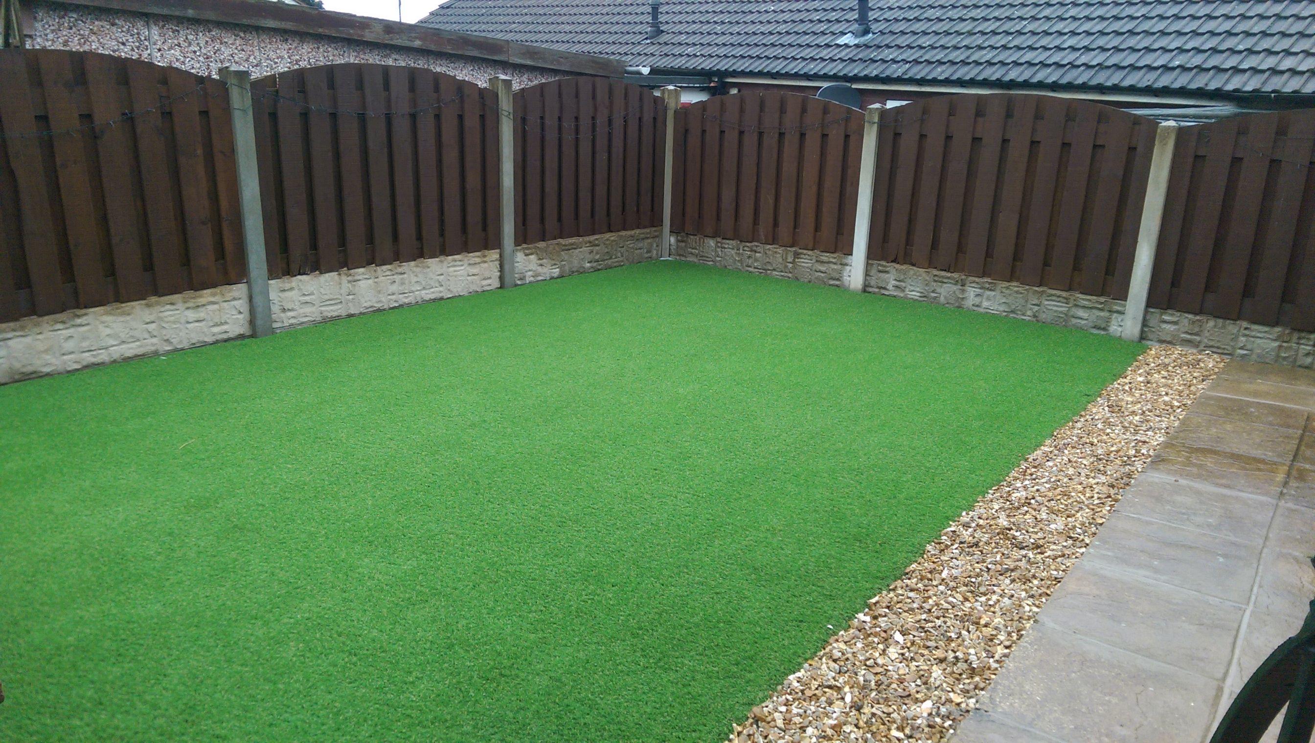 Fußboden Graß Quotes ~ Artificial grass back garden completed with a stone border giving
