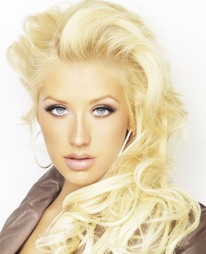 Christina Aguilera Hairstyle Is The Side Swept Long Curls