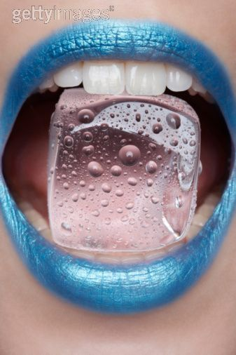 Young Woman Wearing Blue Lipstick Biting Ice Cube In 2020 Blue