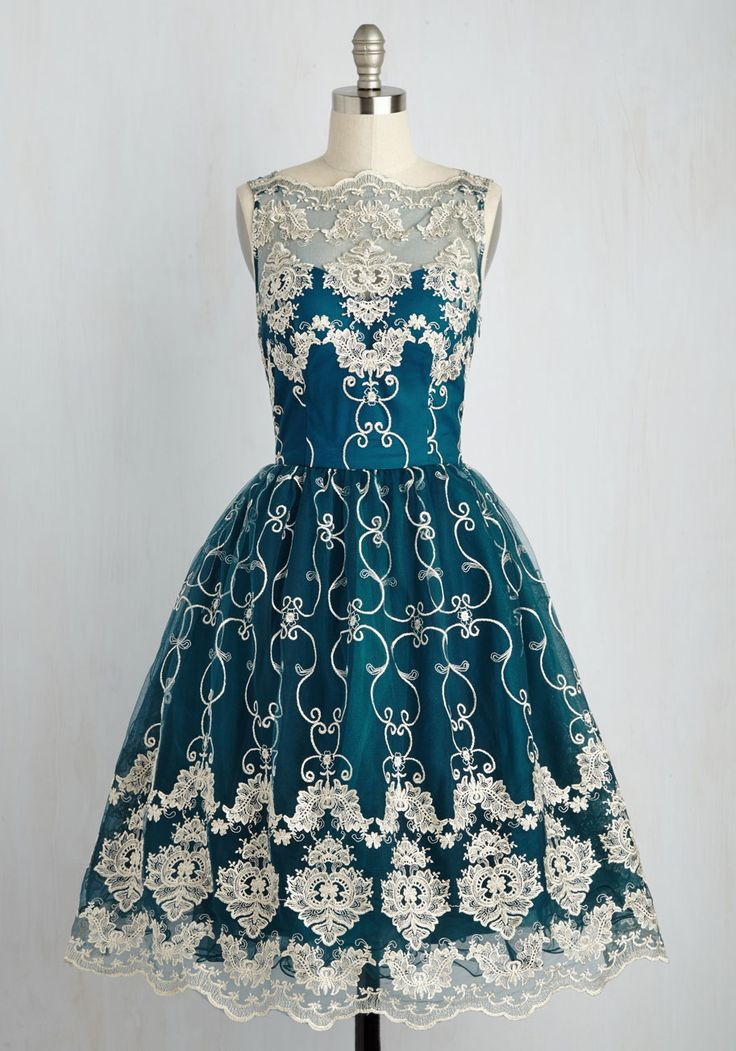 DefiningIconicStyle.com  - Once you don this fit-and-flare dress by Chi Chi London, you'll vow to wear it to every luxe event in your future, no matter what! You look positively royal in its illusion neckline, rich, teal-tinged blue hue, gold-flecked embroidery, scalloped trim, and voluminous skirt. Now, time to take your seat on the style throne!