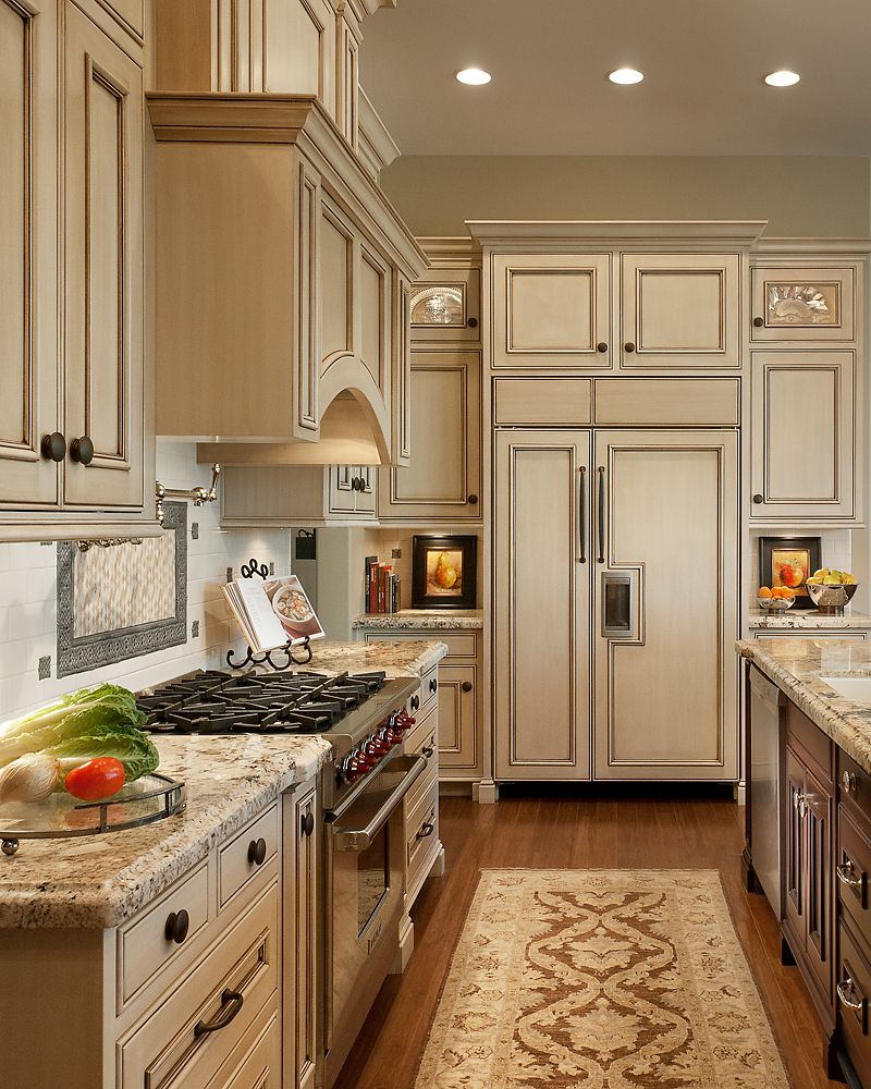 Cream Cabinets With Light Countertops & A Dark Center