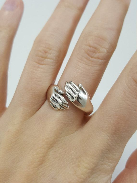 Hug Ring in Sterling Silver silver hug ring hugging hands