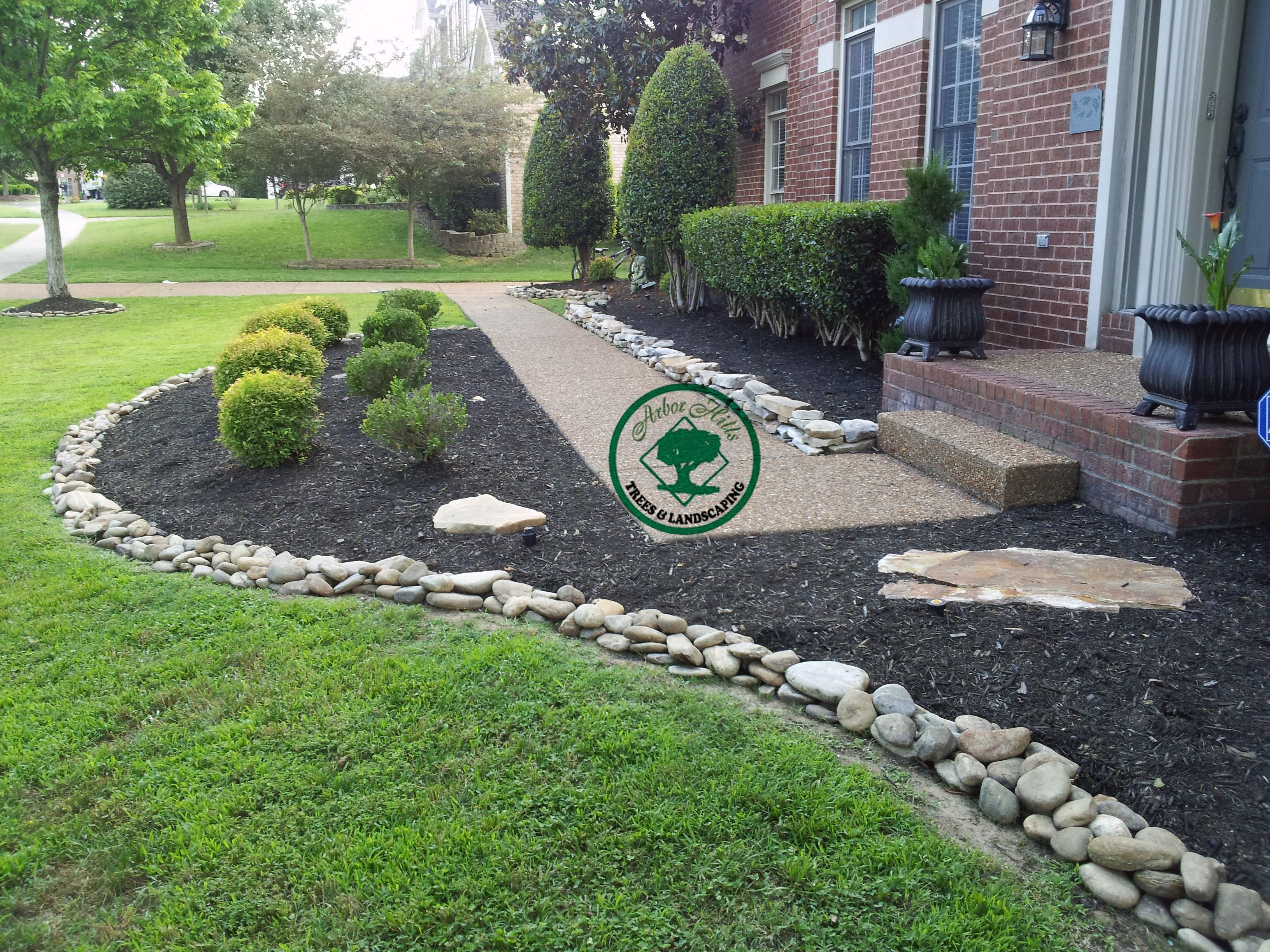 River rock vs mulch landscaping my garden pinterest for Rock garden bed ideas
