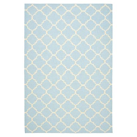 Add a pop of pattern to your master suite ensemble or living room seating group with this chic flatweave wool rug, showcasing a quatrefoil-inspired trellis m...