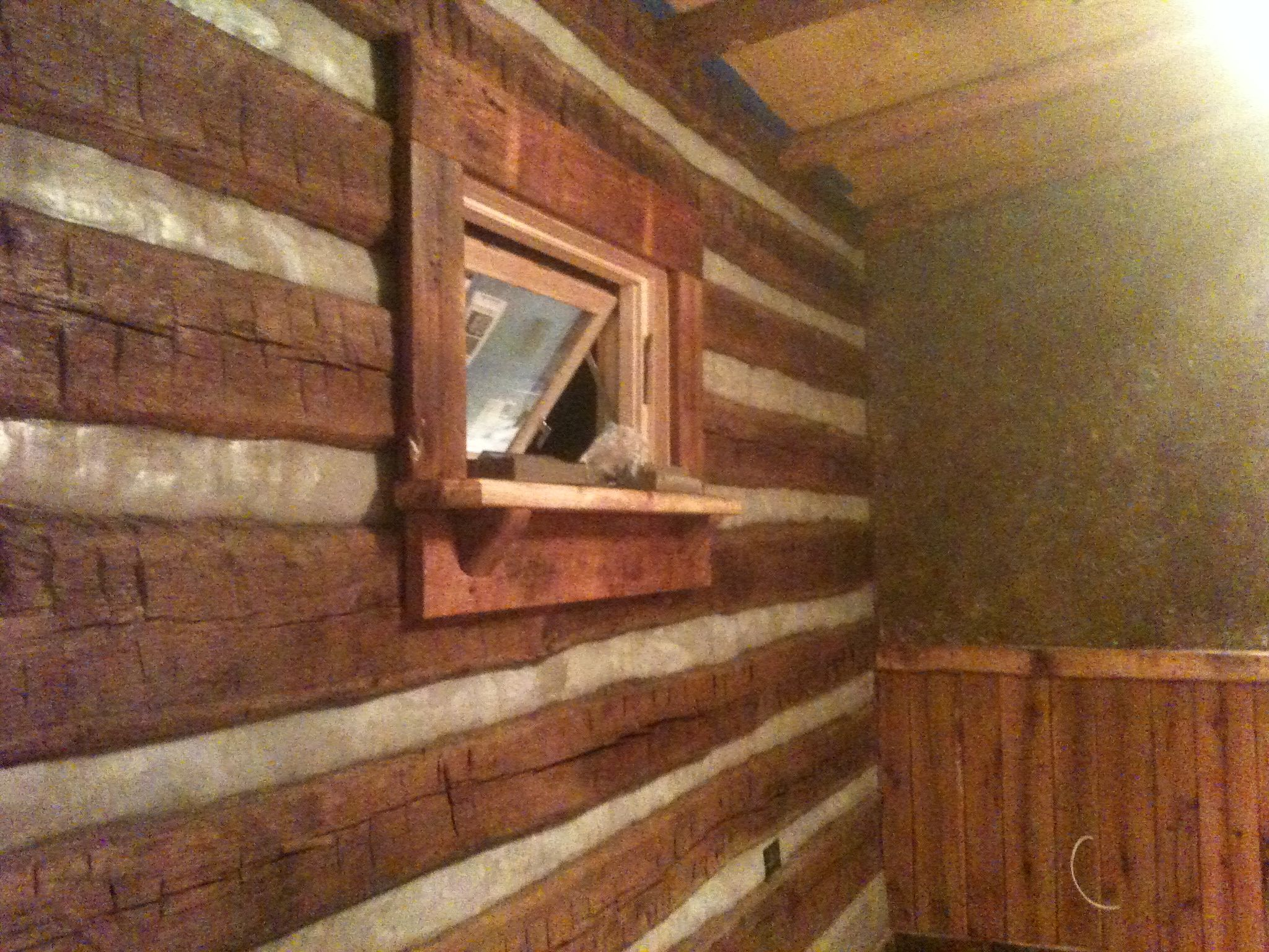 Log Cabins · CHINKED,STAINED,POLYUROTHANED LOGS