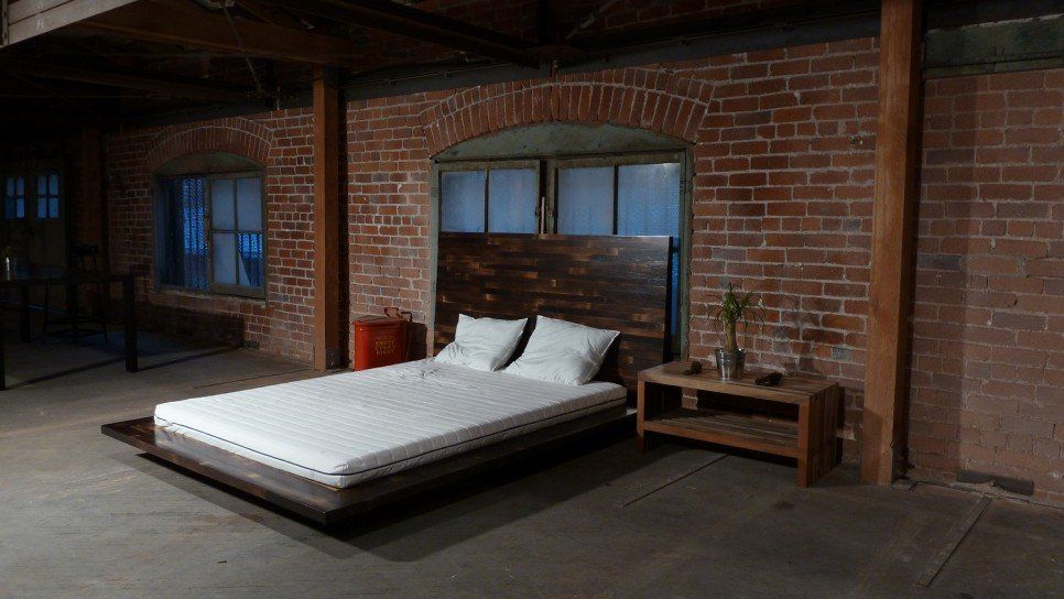 Bedroom Garage Conversion Into Bedroom With Red Brick Wall And
