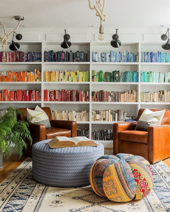 Beau Bookshelves Organized By Color. Rainbow Colored Books With White Walls And  Shelves. Comfy Library Or Living Room With Over Sized Ottoman, Chairs And  Beanbag ...