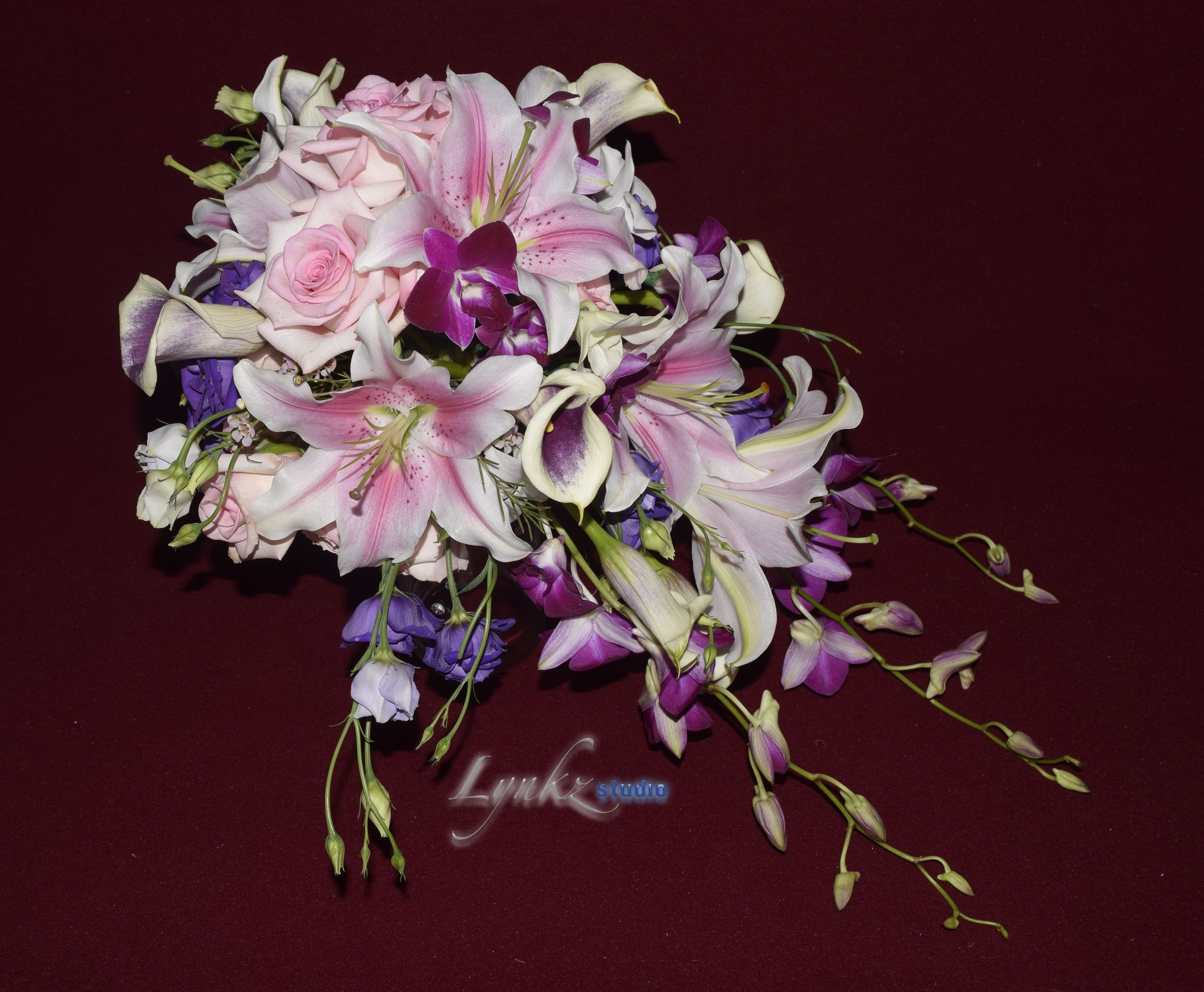 Cascade brides bouquet with purple orchids and pink oriental lily cascade brides bouquet with purple orchids and pink oriental lily izmirmasajfo