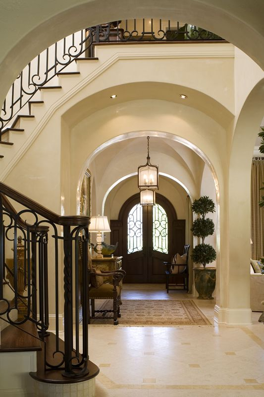 Lovely arched doors foyer and staircase interior design ideas and home decor