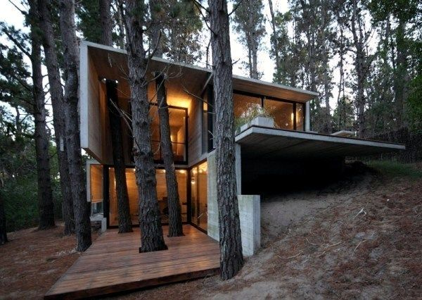 A Modern House Made Of Glass And Wood On The Coast