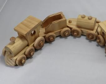 Wooden Toy Train Set With Steam Locomotive And Four Cars