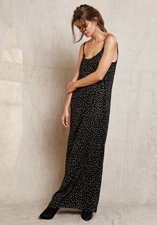 f34793cd7258 This sheer maxi dress is layered over a long slip with subtle star print  for standout style. Perfect for special occasions at this time of year.