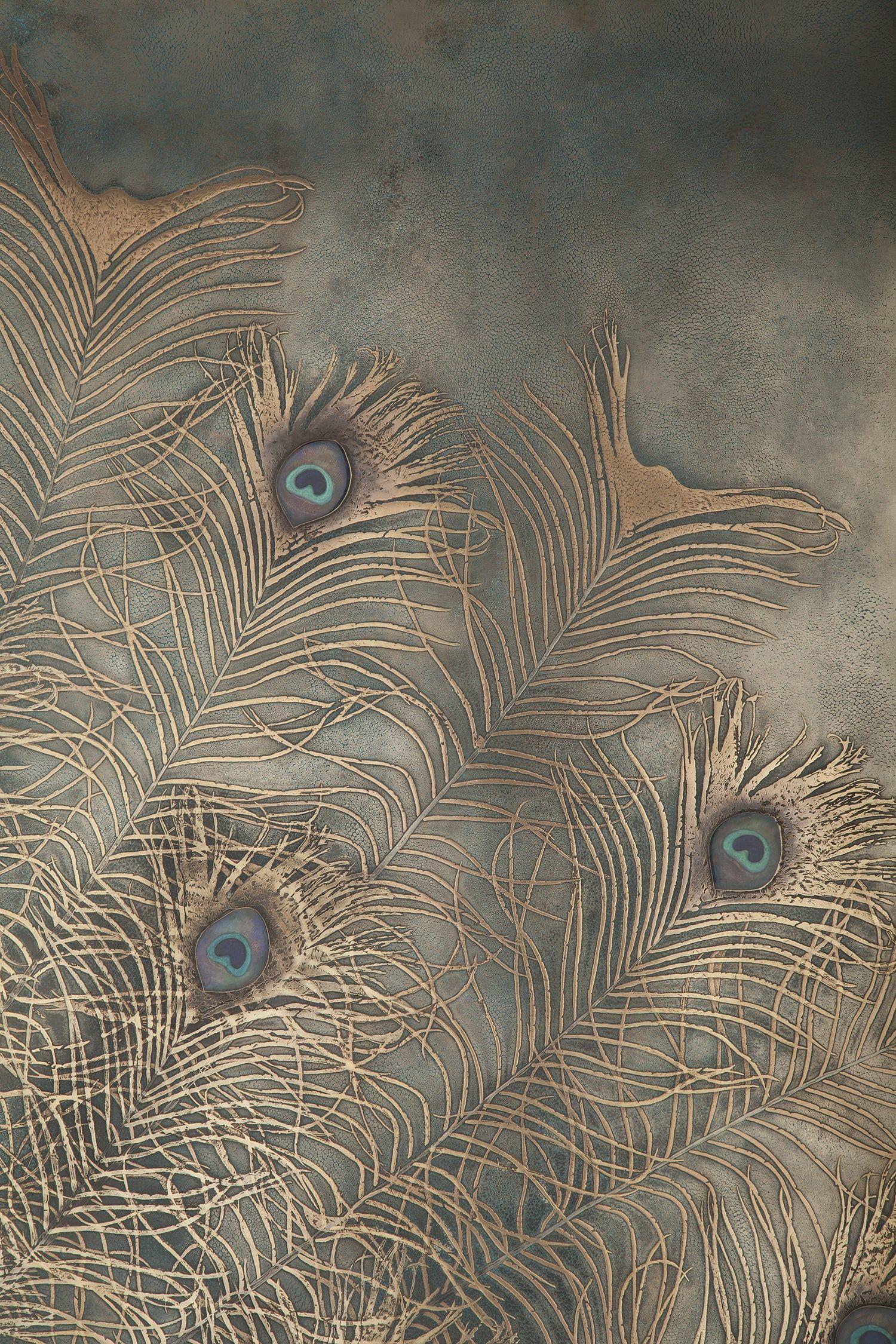 Bronze work peacock detailg basedupon colour