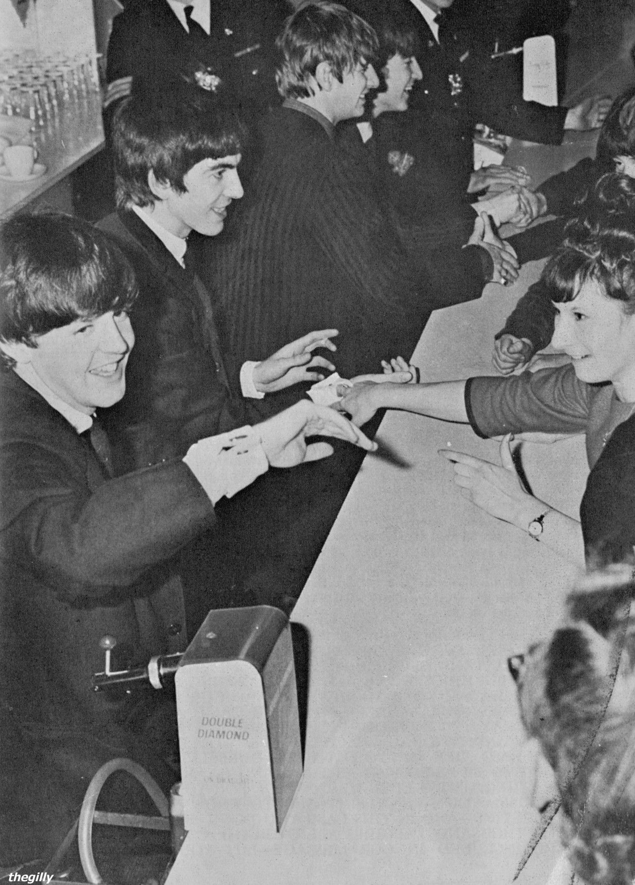 The Beatles shake hands with fans at a meet and greet after a special fanclub performance at the Wimbledon Palais on 14 December 1963. Scan from Beatles Book Monthly No. 7.