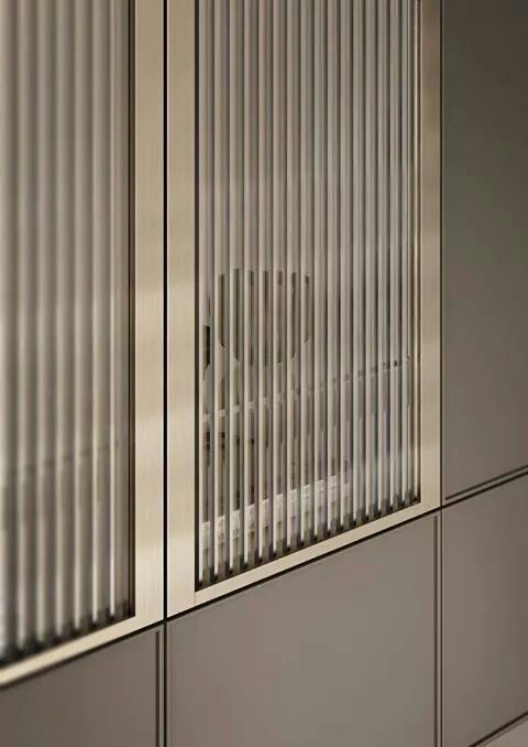 Cabinetry; ribbed glass, gold framing, taupe finish ...