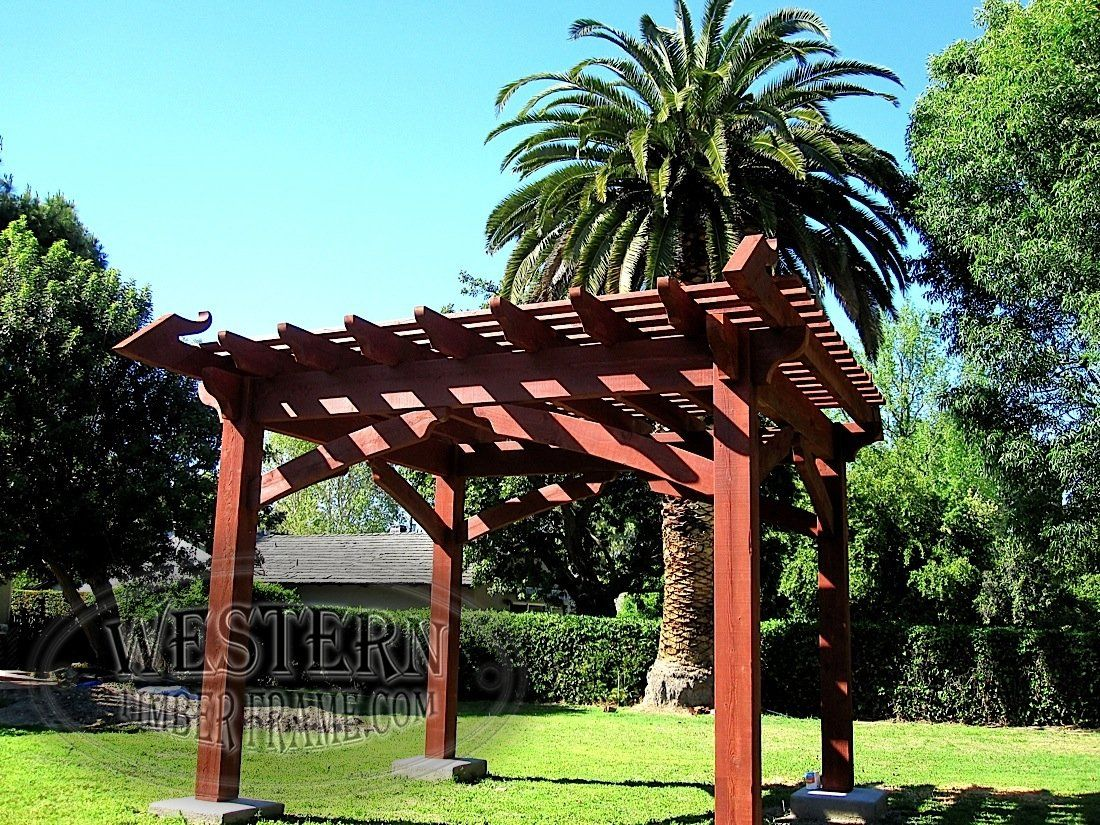 Free standing pergola with custom stain and Roosevelt profile. Custom design on end rafters. Custom knee braces.