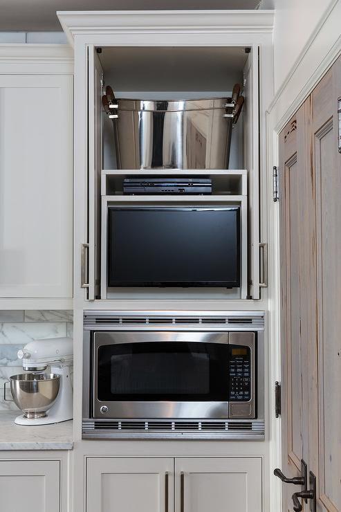 Hidden kitchen tv in cabinet with retractable doors for Tv in kitchen design