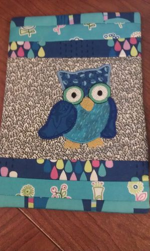 Owl mug rug. I like the dark blue fabric different than he lighter blue chest  and the wings even a different blue than all the rest.