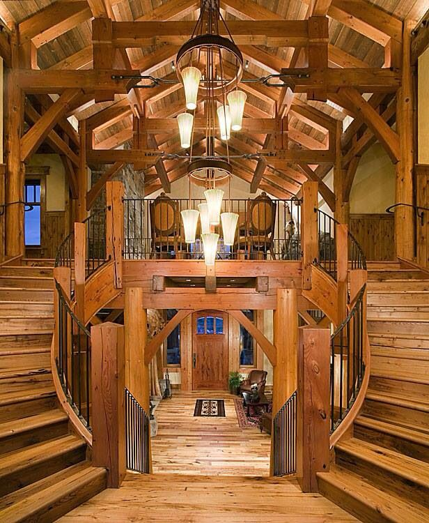 20 Magical And Crafty Ways To Decorate An Indoor Staircase: Log Cabin Grand Entrance