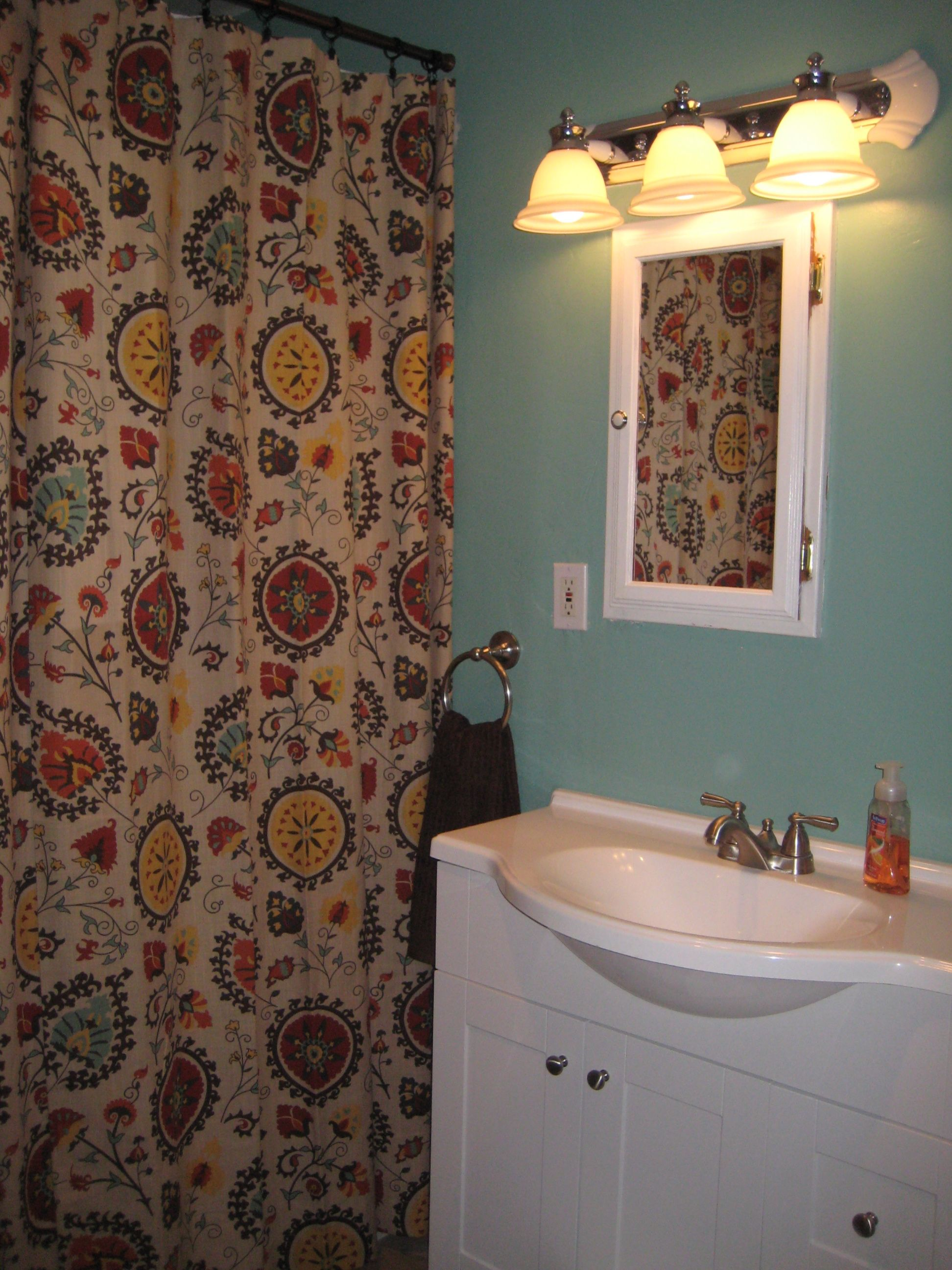 teal bathroom with world market suzani print curtain panel. Black Bedroom Furniture Sets. Home Design Ideas