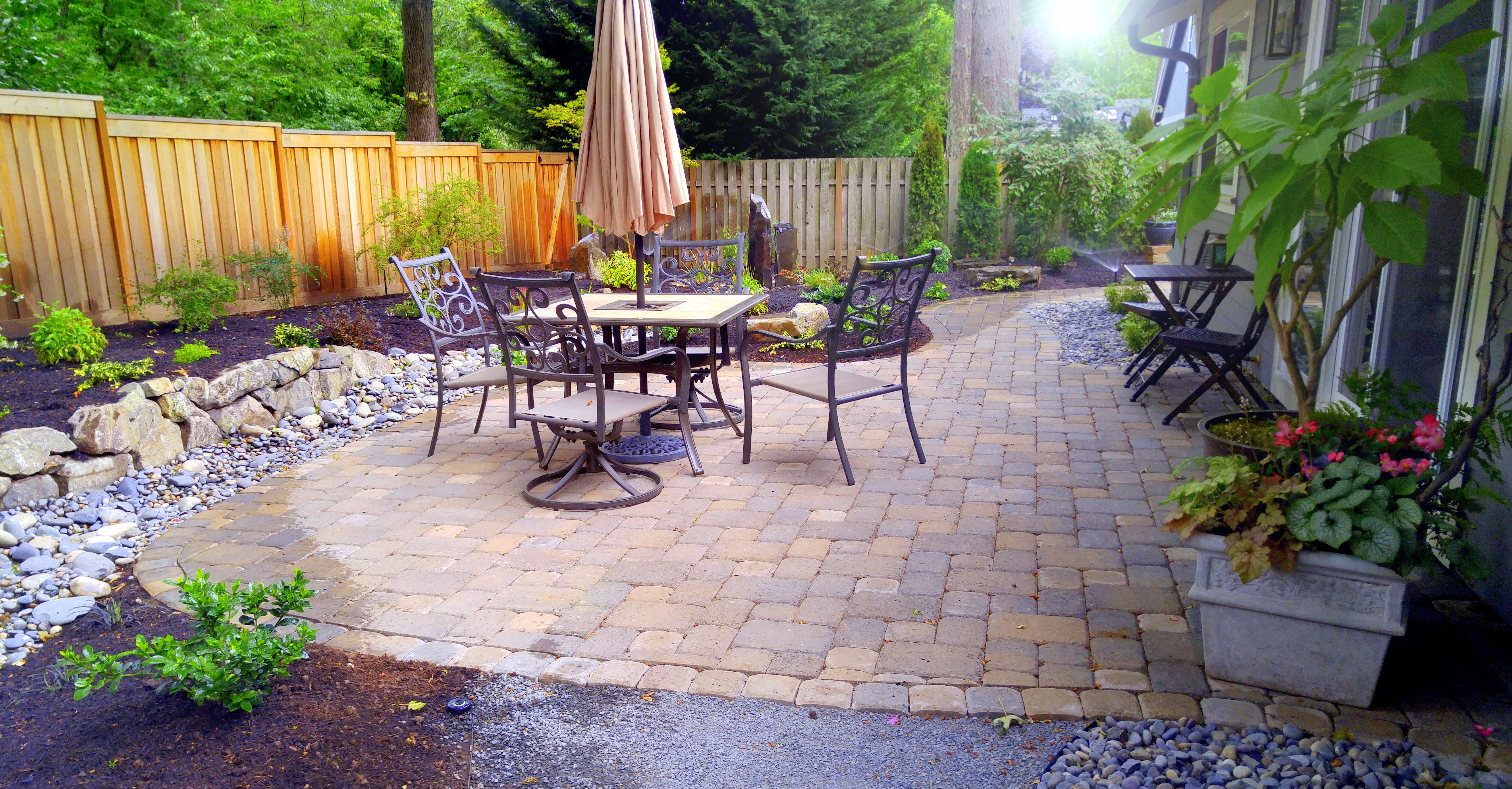 Solid Cedar Fence Paver Patio With Natural Stone Planting Bark Create An Entertainment Space Paver Patio Cedar Fence Patio