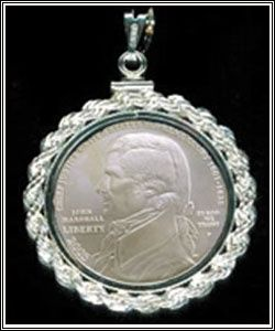 John Marshall Coin Necklace. One of several pieces of jewelry offered by the U.S. Supreme Court Historical Society Gift Shop is a necklace displaying a John Marshall Coin with a rope edge. Marshall was an influential chief justice of the high court.