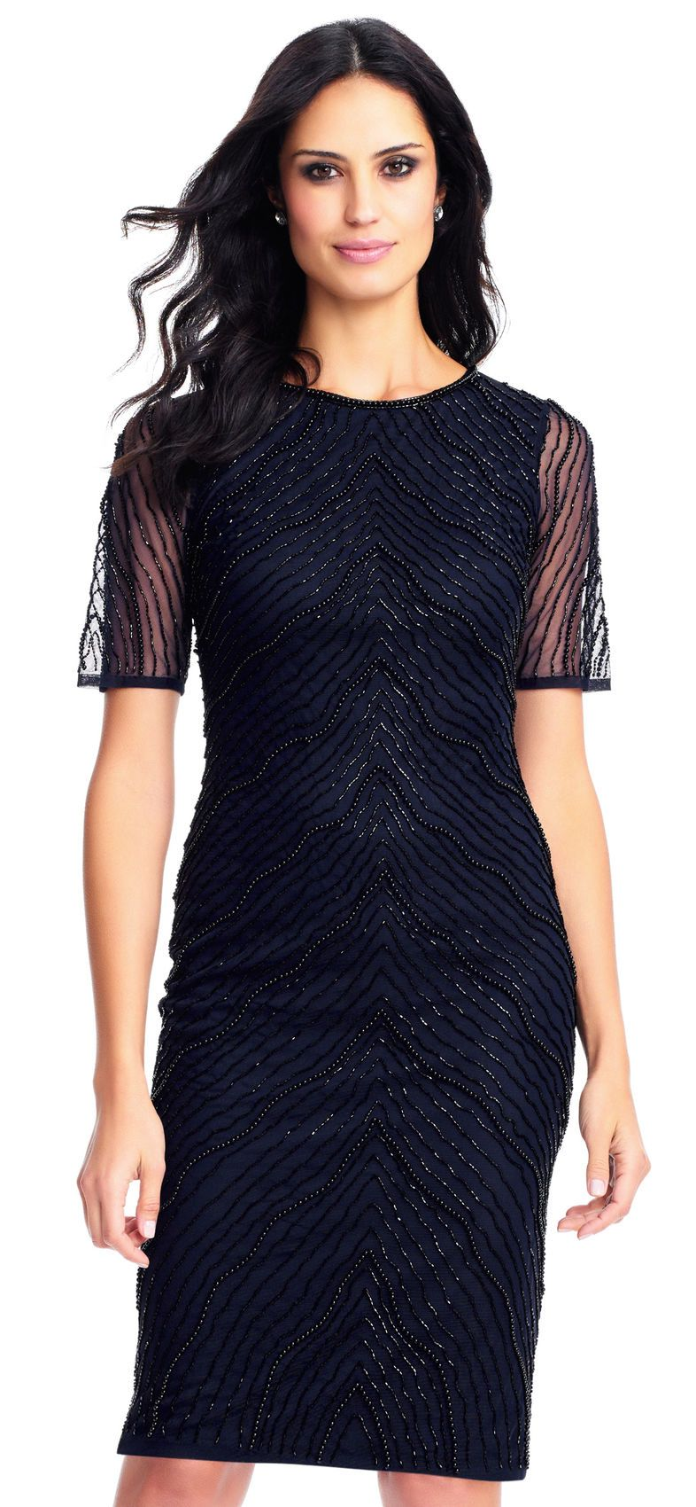 b53e0c39ae9f This cocktail dress features a circle neckline, sheer short sleeves, and a  fitted silhouette. This sheath dress is fully-lined and topped with bead  adorned ...