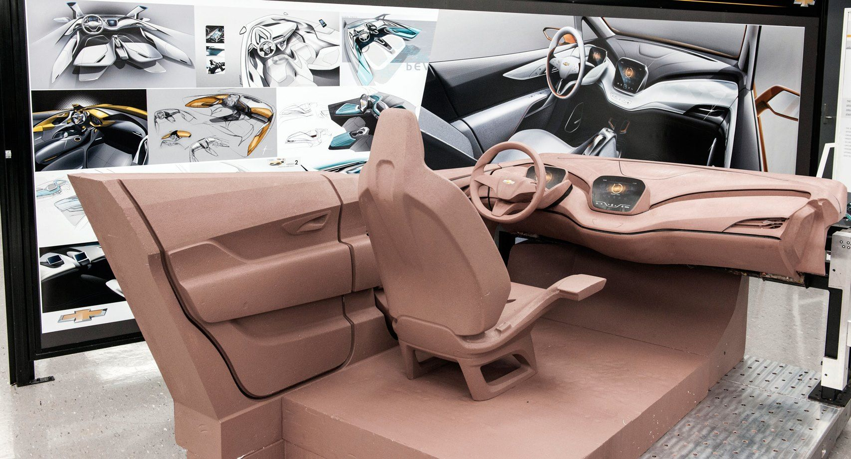 Design of car model - Chevrolet Bolt Concept Interior Clay Model Surrounded By Theme Renders In Gm S Australian Studio