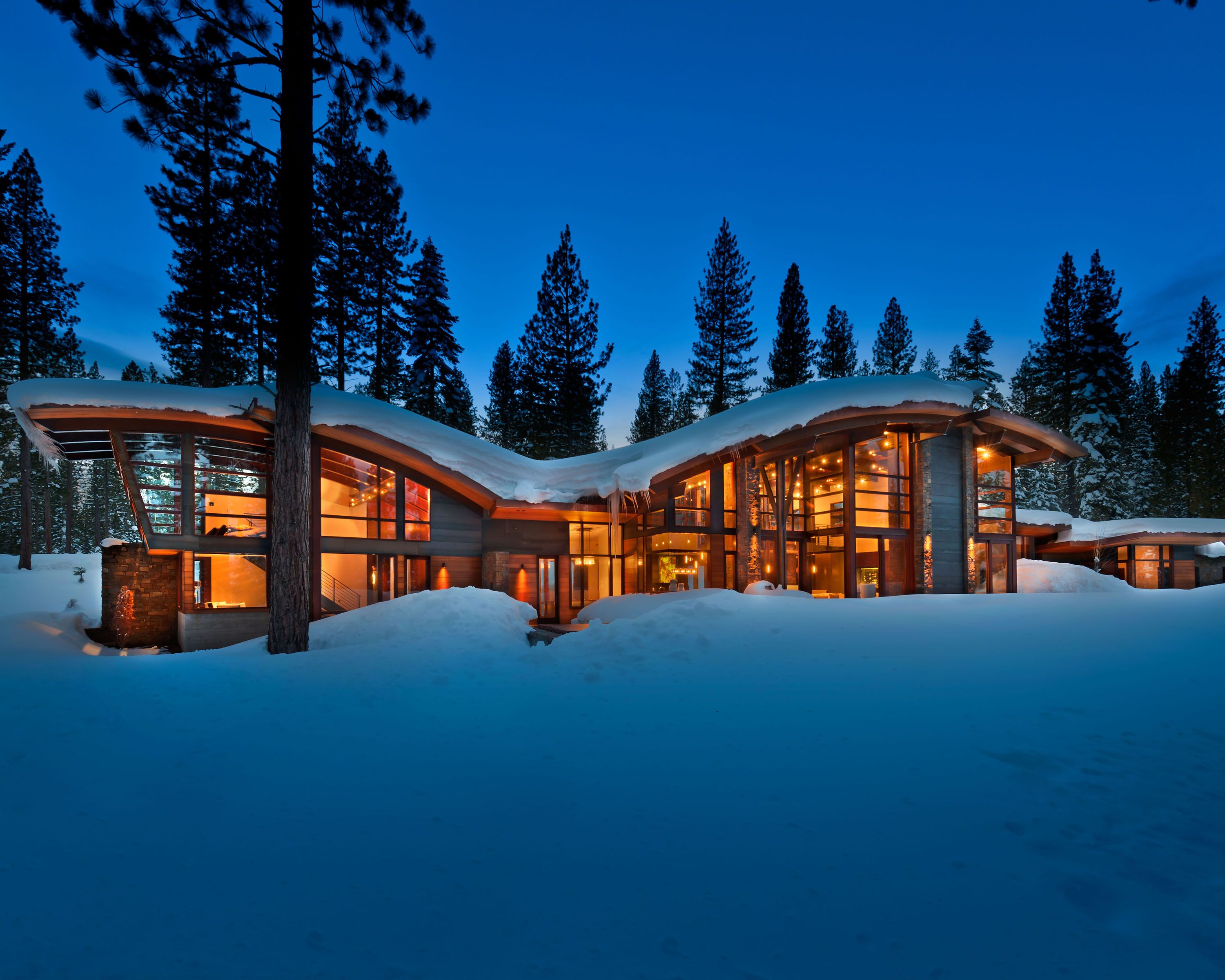 The Snow Covered Exterior Of Modern Mountain Cabin