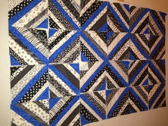 Black and white string quilt with a blue accent strip in the middle of each block. This would look nice with red, purple, green, yellow, etc.