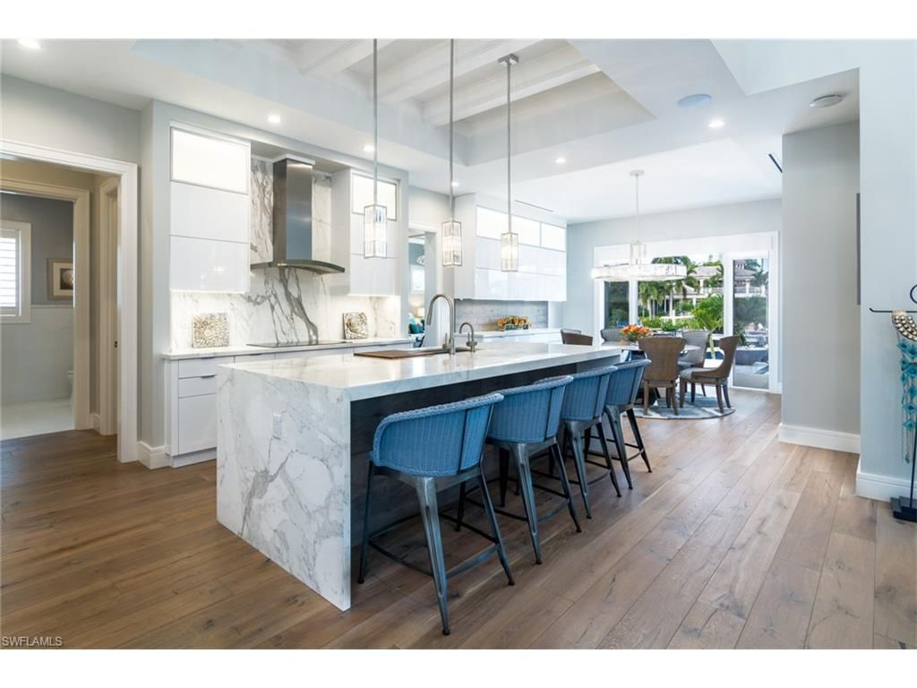 3801 Crayton Rd, Naples, FL 34103 | Coastal Kitchen With Marble Waterfall  Island And